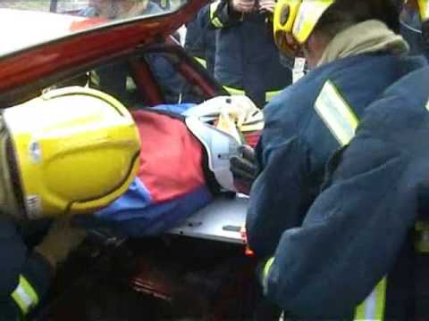 mannequin-man performming as a drag dummy: Demonstration of rapid extrication of casualty from a crash vehicle using a living fire training drill drag dummy at West Midlands Fire Service BTC, Smethwick, Birmingham for West Mids Fire Service on 10/05/2004