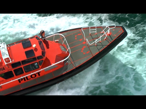 Pilots board cruise ships in choppy waters. Fast pilot boats. Auckland & Malta