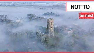 Stunning footage captures church spire piercing thick 'radiation fog' covering village | SWNS TV