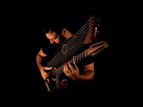 , title : 'Harpborough Fair (21 string harp guitar played by Javier Rubio Carballo)'