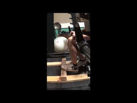 Legs-Seated Single Calf Raise on Smith Machine
