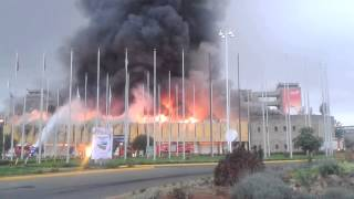 preview picture of video 'JKIA FIRE 10/10 - Plane seen flying overhead a burning arrivals terminal'
