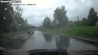 Idiot In Rainy Conditions Crashes