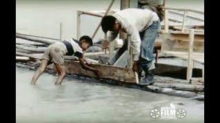 Fish wheel construction on the Tanana River, 1950s