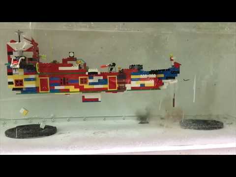 Oddly relaxing video of an underwater Lego ship being blown up by firecrackers, ship blows up at around 1min35sec mark