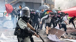 video: Hong Kong police fire tear gas as protesters try to escape besieged university