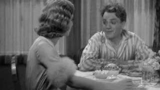 James Cagney smashes a grapefruit into Mae Clarke's face