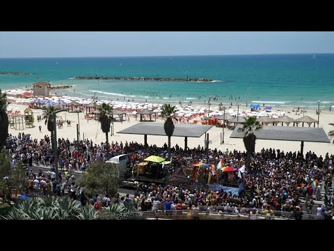 Thousands gather in Tel Aviv as Gay Pride launches   AFP