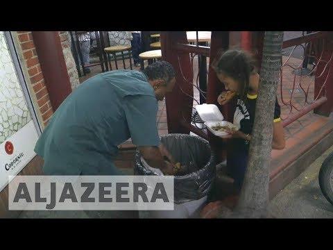 Venezuelan families scavenge for food to survive hunger
