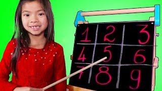 Emma Pretend Play as a Math Teacher