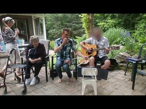 2015 - Awna playing the uke, his Mother( 97)  singing along in a family circle  which will never be broken.  Nephew Nathan playing the Saw.