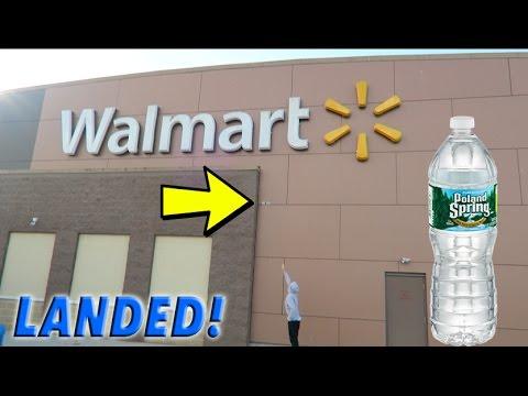 EPIC WATER BOTTLE FLIPS ONTO FAMOUS SIGNS!! *WALMART*