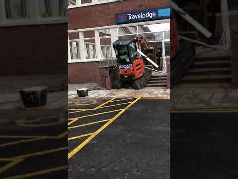 Unpaid contractor destroys travelodge reception with digger.