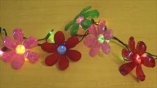 Смотреть онлайн Поделки из пластиковых бутылок – цветы-гирлянды