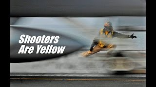 US Navy shooters on aircraft carriers