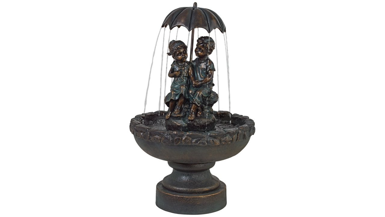 Boy and Girl Under Umbrella Fountain