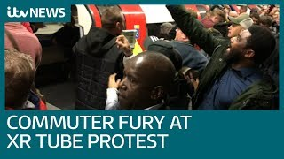 Commuters drag Extinction Rebellion protesters off Tube trains | ITV News