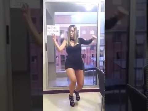dance in black mini dress and sexy high heels