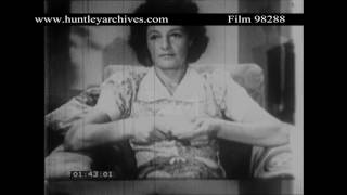 Woman listens to wireless in 1940's Britain.  Archive film 98288