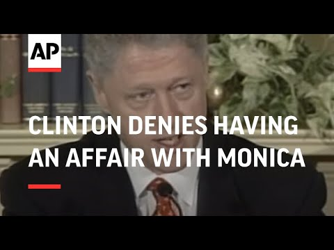 Thumbnail of the video with the image of Bill Clinton. He is in a press conference with his wife beside him.
