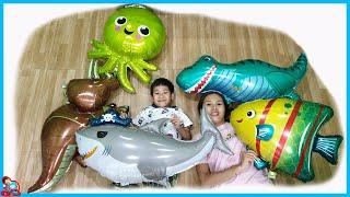 น้องบีม   ลูกโป่งไดโนเสาร์ ปลาหมึก ปลาฉลาม