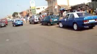 preview picture of video 'Guiné-Bissau - nas ruas de Bissau com uma moto TVS'