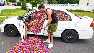 100,000 FEATHERS IN FRIENDS CAR