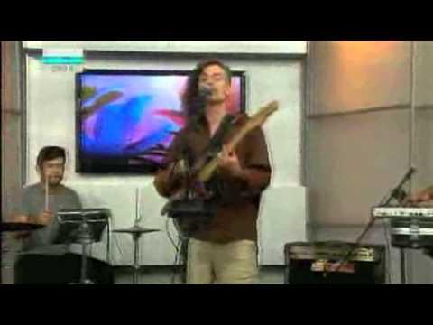 Me playing drums on TV in El Salvador with Rafi eL