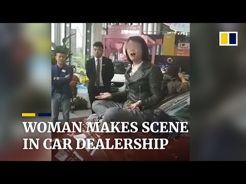 Woman makes scene in car dealership, gains online support
