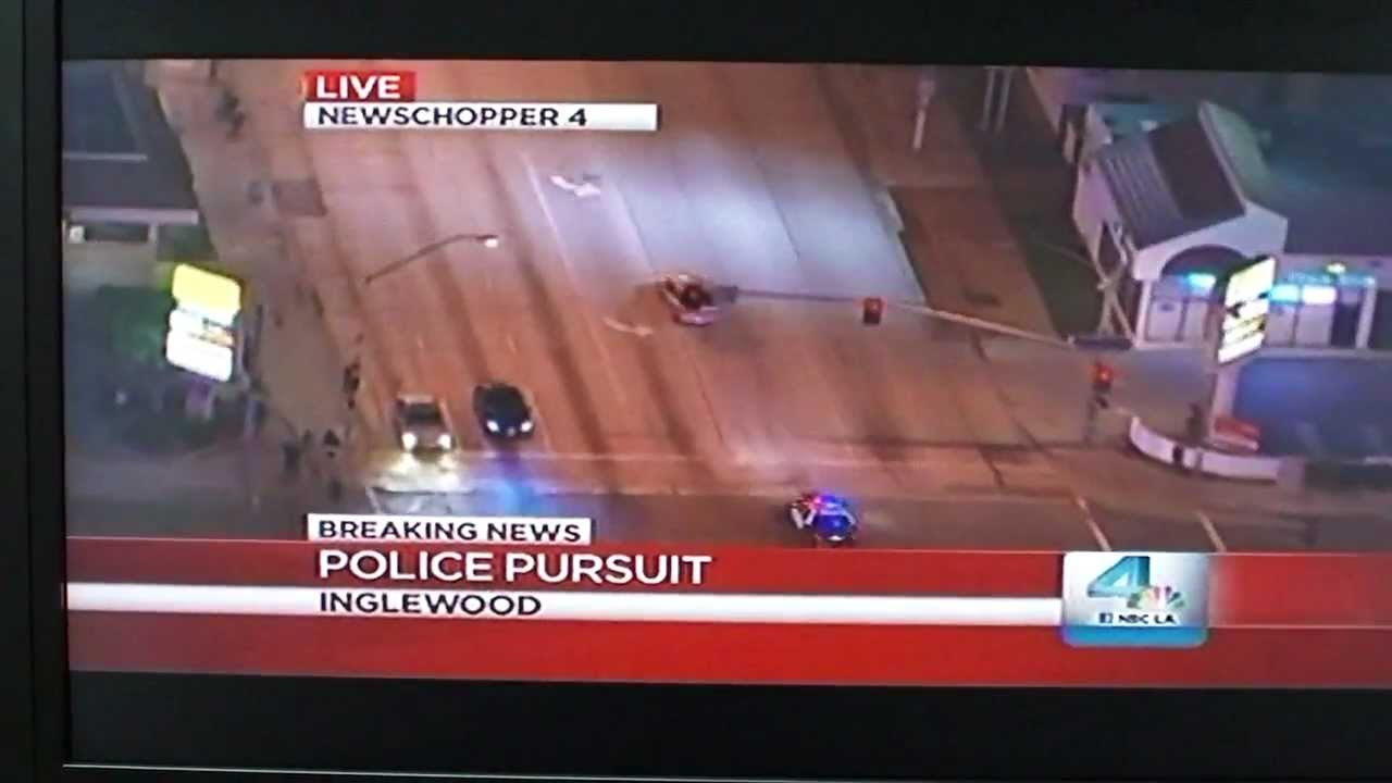 Televised Police Chase Races Past Viewer Watching Televised Police Chase