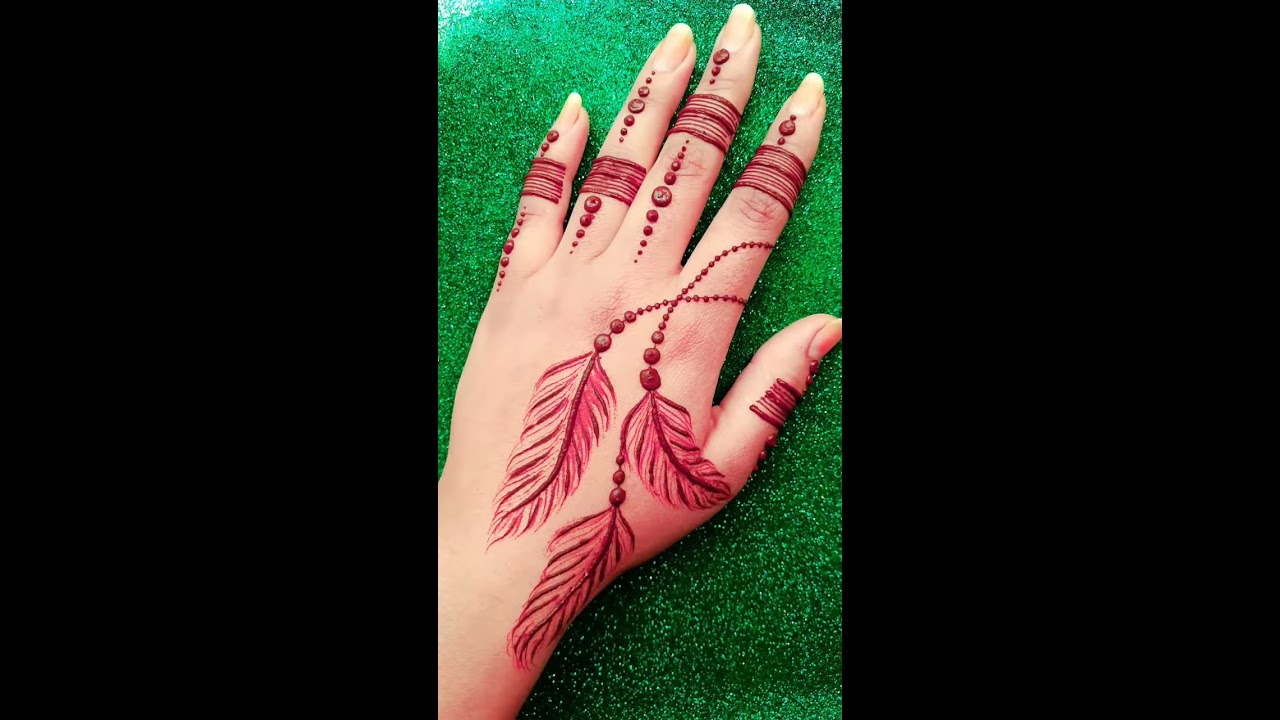 stylish feather tattoo style mehndi design for back hand by india super henna