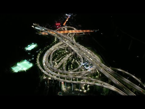 GLOBALink | Aerial night view of roller coaster-like interchange in SW China