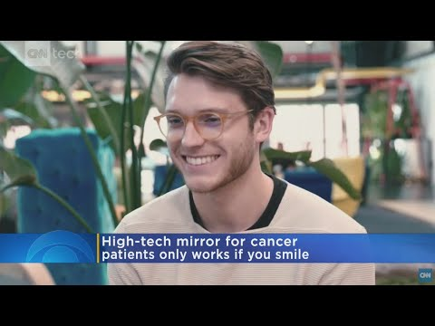 Video: Man designs a mirror that only works until the user smiles to it