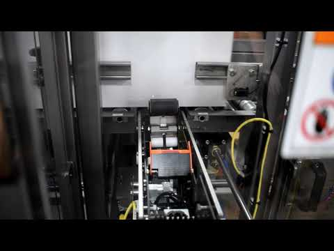 Selladora L-Clip al ancho de la caja con modificación en el transportador