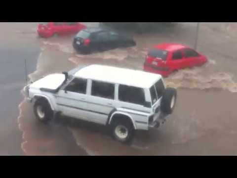 Watch This Massive Australian Flood Clear An Entire Parking Lot