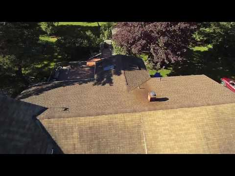 A great before video of a roof replacement job in Poughquag, NY. You can see that this roof is visibly older, stained, and very worn.