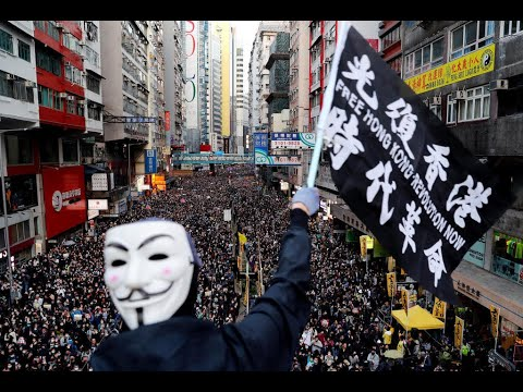 Nearly a million rally in Hong Kong to mark six months of pro-democracy protest movement