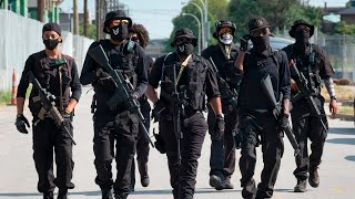 video: Heavily armed protesters march through Louisville demanding justice for Breonna Taylor
