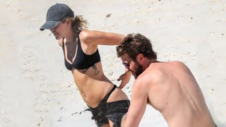 Miley Cyrus and Liam Hemsworth Heat Things Up on the Beach -- See the Pics!