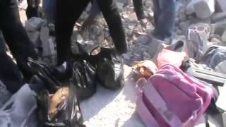 preview picture of video 'درعا | طفس : صور لـ انتشال ضحايا قصف الطيران الحربي اليوم 12-2-2014'