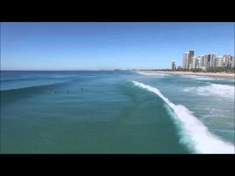 Broadbeach clear water surfing