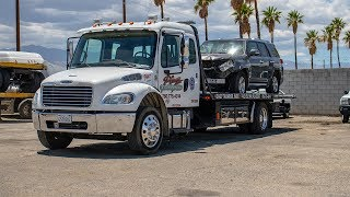 Towing Wrecked Car On A Flatbed