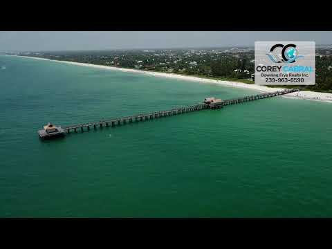 Beautiful Drone Flyover of Naples Pier and Beachfront Real Estate