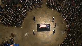 President George HW Bush arrives in Capital to lie in state