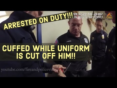 Officer arrested on duty!!! Uniform cut off him as he is cuffed!