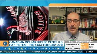 Business Report: Canadian dollar rises, Quantas international flights, GameStop won't stop