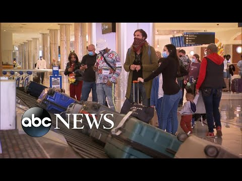 Coronavirus concerns grow as Americans travel for the holidays