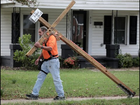 'Message of love': York man carries cross four miles everyday