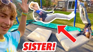TEACHING MY 12 YEAR OLD SISTER A BACKFLIP ON THE TRAMPOLINE!