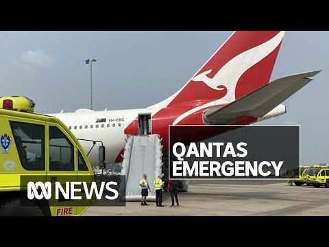 Qantas passengers use emergency slides to evacuate plane at Sydney Airport | ABC News